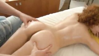 Redhead with curly hair enjoys a massage fuck