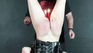 Hooded slave Chaos whipped in suspension bondage and female leather fetish