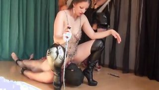 Playing with her sex slaves