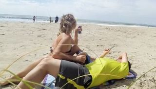 Real amateur public handjob on the beach
